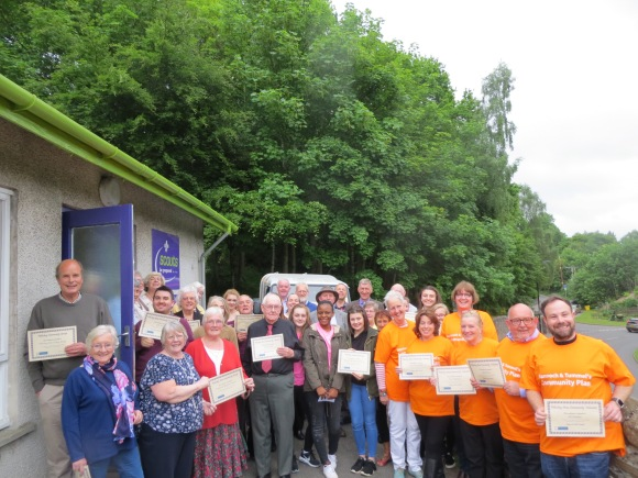 Volunteers with their certificates